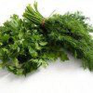 Тушкована зелень з часником